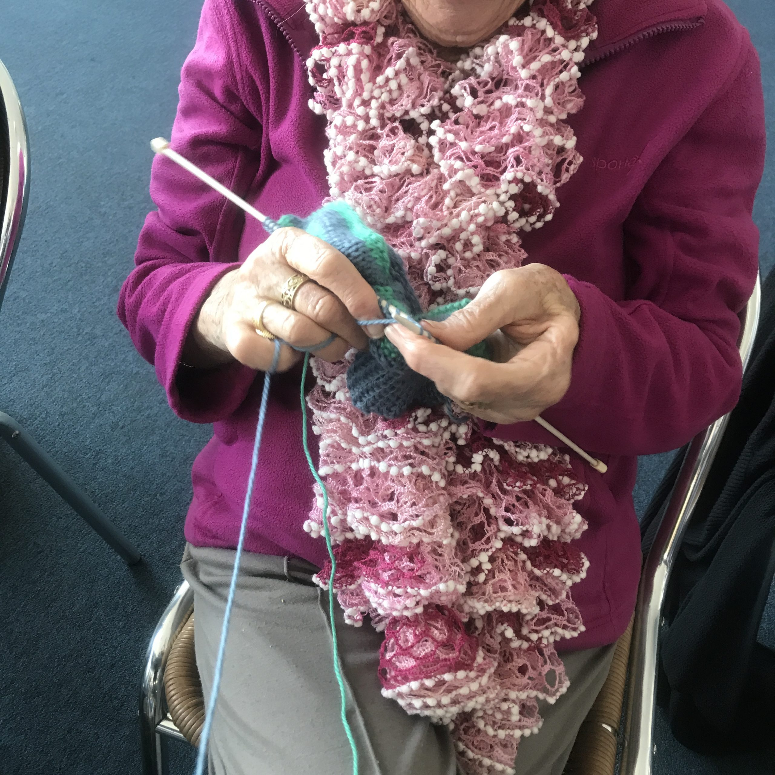 lady's hands doing knitting