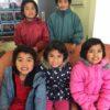 Children in their new warm coats