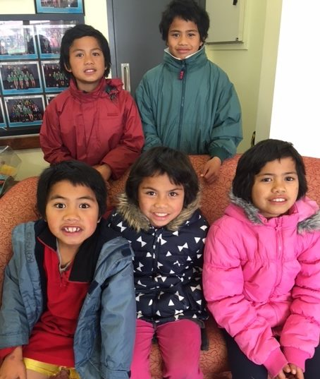 Children in their new warm coats
